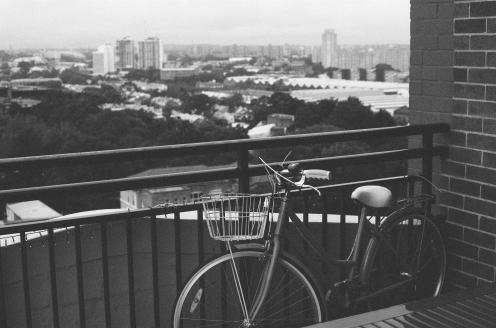 Bike on a railing outside Sydney apartment - Film
